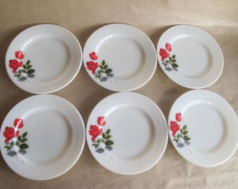Six JAJ Pyrex June Rose sandwich plates.