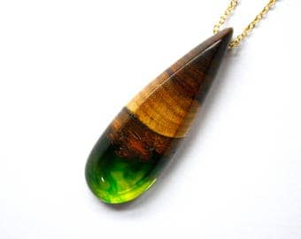 Long tear drop shaped pendant / necklace handmade from Australian wood and a mixture of emerald green and avocado green resin