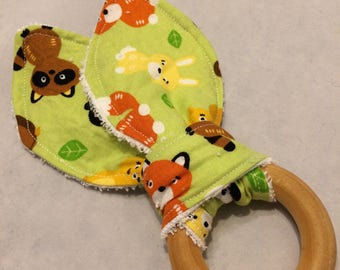 Natural maple wooden teething ring with green woodland animal fabric