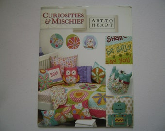 Curiosities and Mischief Instruction Booklet