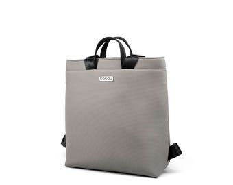 Small light grey backpack with light inside. 2 inside pockets and 1 outside pocket. Straps made of seatbelt - Boogie S