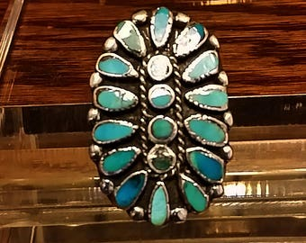 A Repaired custom Sterling Silver Zuni Ring with blue Gem Turquoise