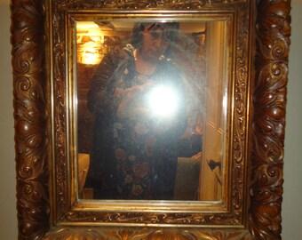 Antique bronzed gilt gesso Florentine style mirror
