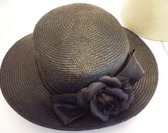 Ladies BLACK Straw Wide Brimmed Hat tapering to back with Rose in BLACK satin banding above brim By British Hat Guild