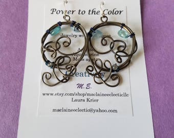 Steel, copper, gold plated, and silver free formed wire accented with color copper and gemstone beads