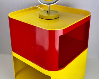 A mix of red and yellow Componibili storage containers by Kartell Italy.