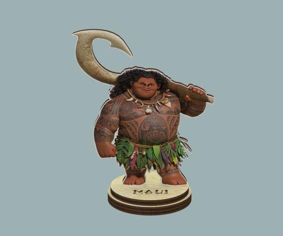 Maui moana disney wood figurine on a stand