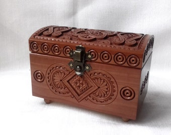 Wooden walnut jewelry box. Wooden box carved