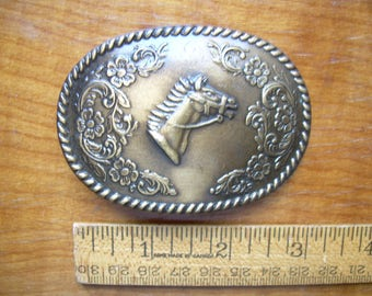 """Vintage 1970's BRASS HORSE BUCKLE is post-style. 3 inches long. Fits a 1  3/8 in. wide belt. Nice """"antiqued"""" finish. 2 Available."""