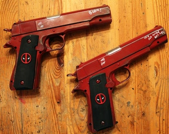 Deadpool twin 45. Cal Pistol with custom grips. Also available for Lady Deadpool.