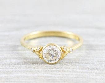 1 carat diamond round engagement ring with accent stones floral flower nature inspired ring in 18 carat gold unique