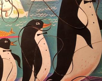 """Vintage 1960s PLAYskool 6-piece preschool wooden puzzle. """"Penguin Parade."""""""