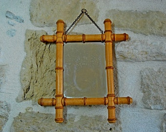 Vintage French faux bamboo mirror with frame. Medium size with original antique mirror and chain. Bohemian style.