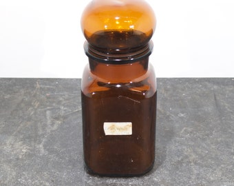 Vintage pharmacy bottle with cap made of glas