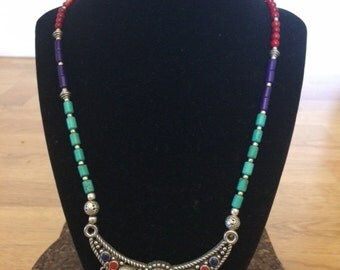Ethnic stone necklace in a silver finish with turquoise, purple and red stones
