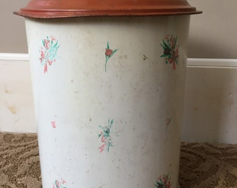 Vintage waste can, step open type, patented at one time.  Shabby decor for any room.  Metal can inside an outer metal covering.