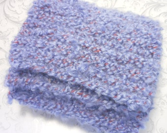 Childrens knitted hand scarf in wool soft to keep warm.