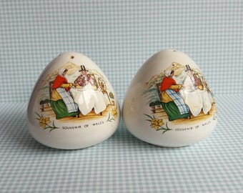 1960s Souvenir of Wales Salt and Pepper Shakers - White ground with Women Snowdonia Daffodils Montage
