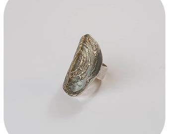 Unisex ring in silver oxidized with iscrustaciones copper law