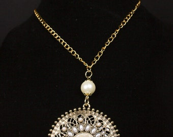 Pearl-Like Beads on an Ornate Golden Disk