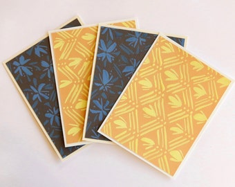 Modern hand-painted stationery: vibrant geometric and floral patterns