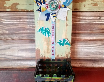 Recycled license plate flower on reclaimed wood with basket