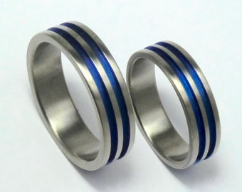 A pair of anodized titanium engagementrings. Hand crafted titanium rings. Titanium jewelry.