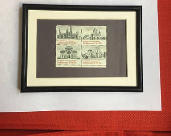5x7 Black frame, white mat of four stamps depicting US Architecture
