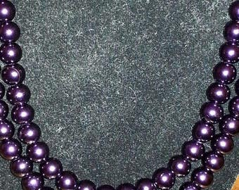 Purple double stranded beaded necklace