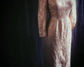 Early 1960s full length wiggle dress in gold silk brocade