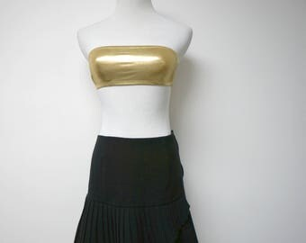 "Black electric pleats . low waist . wool tri blend skirt . low waist 31"" . fits a small to medium . made in USA"