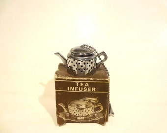 Vintage Tea Strainer Infuser Teapot Shaped With Original Box NO PLATTER Box Is Funky But Strainer Looks Good