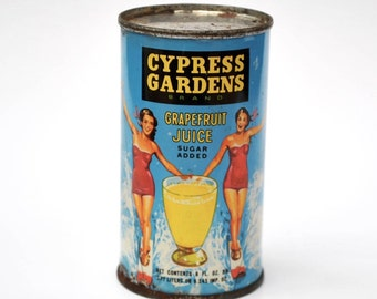 Vintage 1950's Cypress Gardens grapefruit juice can, water skiers, bathing suits, from Snively Groves, Winter Haven Florida