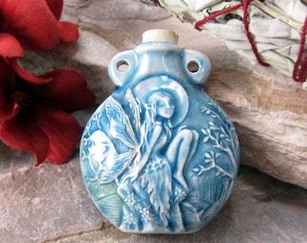 Peruvian Ceramic Raku Sitting Fairy Bottle