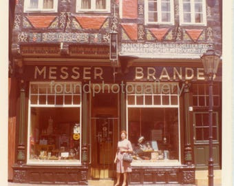 Vintage Photo, Vintage photo of a woman standing in front of an old building, 1652, in Celle Germany.  Color Photo,  Old Photo