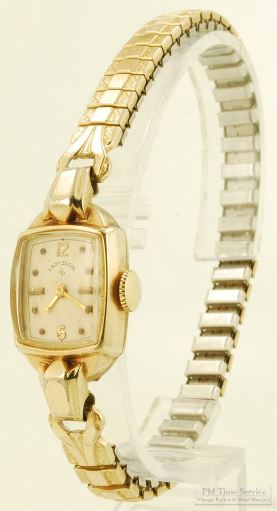 "Elgin vintage ""Lady Elgin"" wrist watch, 17 Jewels, yellow gold filled rectangular smooth polish case with elaborate center lugs"