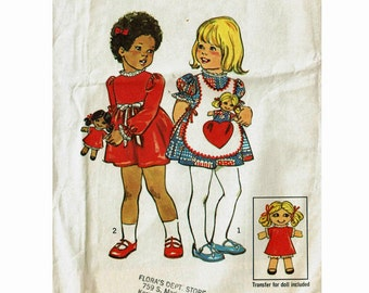 Adorable toddler Dress Apron and Doll Size 2 Uncut 1970s Sewing Pattern breast 21 Toddler Simplicity 6684