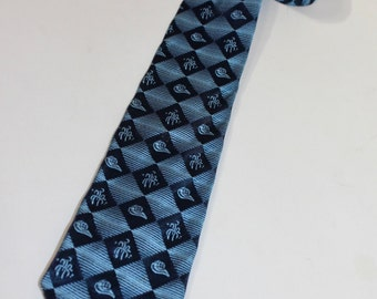 vintage 1950's Men's neck tie. Jacquard woven design - Harlequin pattern with Fade stripe. Navy and Light Blue