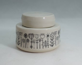 Porcelain thrown lidded pot with FLANTS decoration