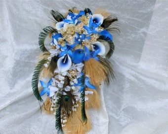 Cascaiding bridal bouquet with royal blue, gold, chamapgne flowers, feathers, rhinestones, ostrch feather, peacock feather, silk flowers