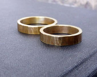 Simple wedding ring in textured brass. Dark patina wedding bands. Unisex rings his and hers.