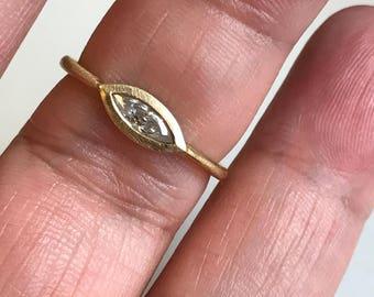 Bezel set marquise diamond solitaire engagement ring