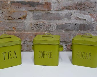 Vintage Coffee, Tea, and Sugar canisters or storage jars.