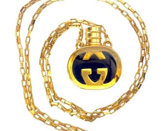 Vintage Gucci gold and navy round shape perfume bottle necklace with iconic logo mark. Perfect rare Gucci gift