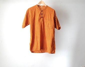 women's 90s SOUTHWEST ikat collared burnt orange striped henley wooden button shirt