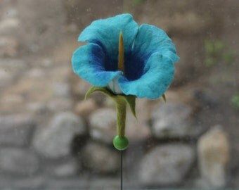 Flower felted on a concrete block
