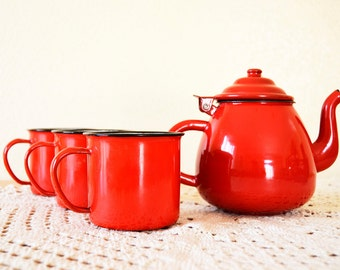 Set of red teapot and three vintage bowls