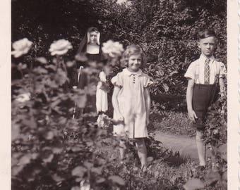 Children In Garden - Nun In Background - Weird, Creepy c1939 Snapshot Photo