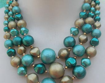 50s - 60s Turquoise and emerald greens and textured old-gold bead 3 strand necklace each separated by a gold seed bead.