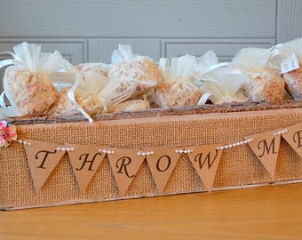30 confetti bags, filled with natural biodegradable rose petal confetti in a wooden tray with bunting